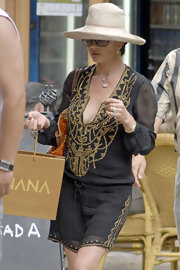 Catherine Zeta Jones kept the sun out of her eyes with this sun hat, while shopping in Spain.