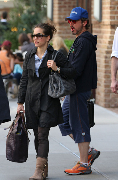 Susan Downey went to catch a flight carrying a woven gray leather tote and another oversized bag.