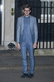 Henry Holland's monochromatic blue suit showed he's not afraid of color while out in London.