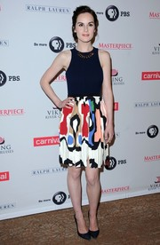 Michelle Dockery finished off her look with dark blue denim pumps.