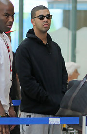 Drake rocked classic shades while catching a flight at the airport.