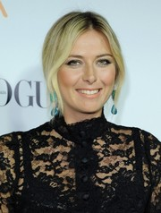 Maria Sharapova styled her hair in a romantic chignon with center-parted tendrils for the Dream for Future Africa Foundation Gala.