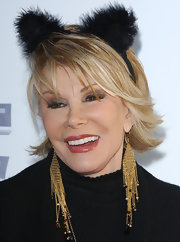 Joan Rivers wore a dazzling pair of long gold earrings at a fundraiser in Santa Monica.