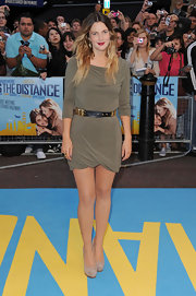 Drew Barrymore showed off her slim figure in a sleek cocktail dress, which she cinched with a studded belt.