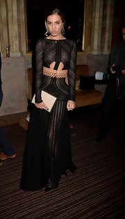 Amber Le Bon rocked a sheer cutout dress at 'The Great Gatsby' drink reception in London.