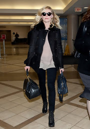 Kirsten Dunst gave her outfit a ladylike twist with Dolce & Gabbana's chic new structured top handle bag.