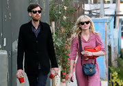Kirsten Dunst strolled through Silverlake donning a navy blue cross body bag.