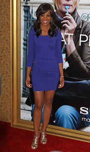 Shaun Robinson gave her ladylike black mini dress a shiny twist with gold strappy sandals.
