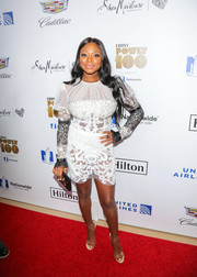 Naturi Naughton paired her dress with on-trend PVC sandals.