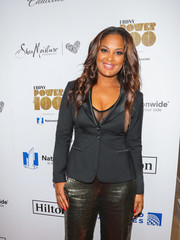 Laila Ali paired a fitted black jacket with gold trousers for Ebony's Power 100 Gala.
