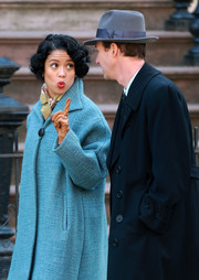 Gugu Mbatha-Raw wore camel-colored leather gloves with a blue coat while filming scenes for 'Motherless Brooklyn.'