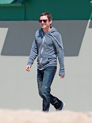 Elijah Wood was spotted wearing a washed out hoodie and a pair of loose pants.