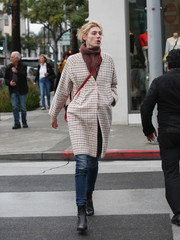 Elizabeth Debicki looked cozy in a grid-print coat and a knit scarf while shopping in Beverly Hills.
