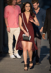 Elizabeth Gillies oozed sex appeal on 'Kimmel' in a burgundy dress featuring a deep-V neckline and a split skirt with a mini underlay.