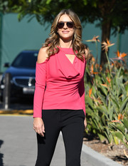 Elizabeth Hurley headed to 'Extra' looking cute in a hot-pink cowl-neck top by Lavish Alice.