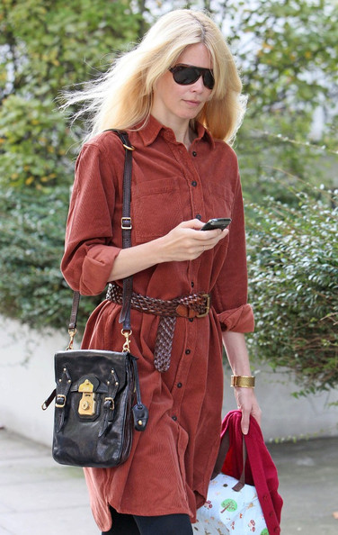 Claudia paired her button down shirt with a leather multi-buckle shoulder bag.