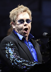 These purple rimless shades have Elton's initials in rhinestone.