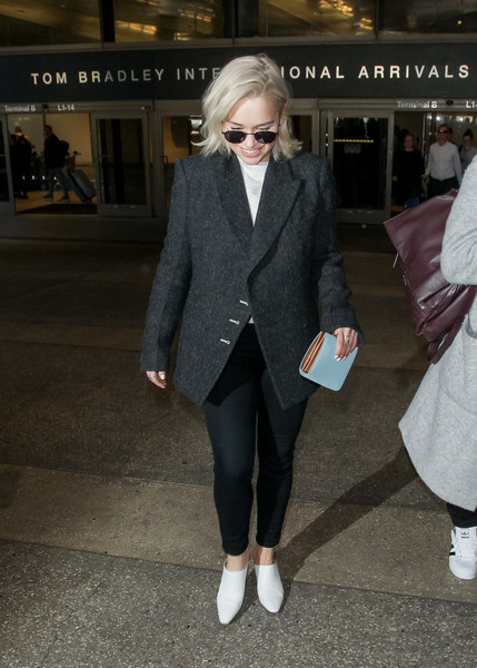 Emilia Clarke finished off her airport look with a pair of white mules.