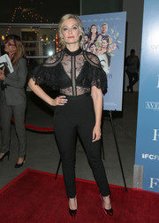 Beth Behrs showed some skin in a black sheer-bodice jumpsuit by Self-Portrait at the premiere of 'The Female Brain.'