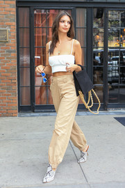 For her arm candy, Emily Ratajkowski chose a stylish black suede tote by Jacquemus.