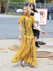 Emma Roberts turned heads on the streets of New York City in a semi-sheer star-print maxi dress by Coach.