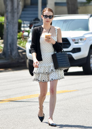 Emma Roberts topped off her frock with a black cardigan.