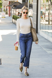 Emma Roberts grabbed some iced coffee wearing a long-sleeve white tee and cropped jeans.
