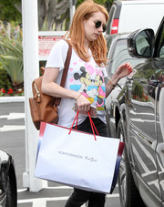 Emma Roberts stepped out for some shopping carrying a brown leather backpack by Anya Hindmarch.