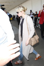 Emma Stone was spotted at LAX carrying a chic nude leather shoulder bag by Gucci.