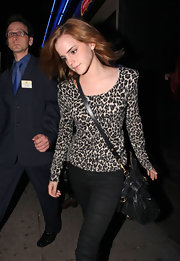 Emma looks fierce in a strong-shouldered, leopard-print top with skinny black jeans.