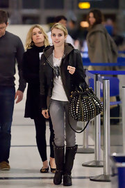 Emma paired her flat boots with a heavily studded shoulder bag.