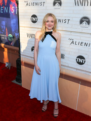 Dakota Fanning charmed in a baby-blue halter dress by ALEXACHUNG at the Emmy FYC event for 'The Alienist.'