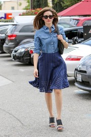 Emmy Rossum balanced out her top with a chic blue grid-patterned skirt.