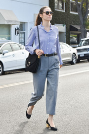 Emmy Rossum was seen out in LA looking office-chic in a blue ruffle-collar button-down.