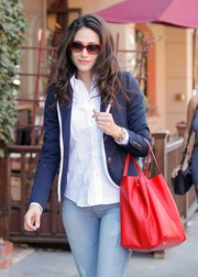 Emmy Rossum took a stroll in Beverly Hills wearing matching red cateye sunglasses and leather tote by CH Carolina Herrera.