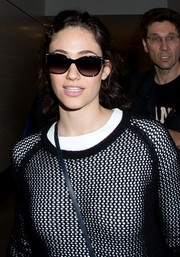 Emmy Rossum hid her eyes behind a pair of bedazzled wayfarers as she made her way through LAX.