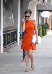 Emmy Rossum took a stroll looking cute in a red-orange mini dress.