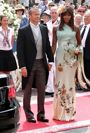 Naomi Campbell put her most fashionable foot forward at the royal wedding in Monaco in this gorgeous ombre one-shouldered dress with delicate embroidered flowers.