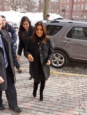 Eva Longoria stepped out in cold weather wearing a black wool coat with gold buttons.
