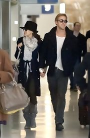 Eva Mendes was spotted with beau Ryan Gosling at the Paris airport in chic fall style, complete with slouchy gray boots.