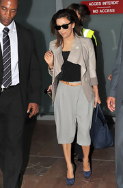 Eva Longoria showed off her coveted leather jacket, while traveling through Nice airport.
