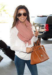 Eva Longoria looked lovely in this peach scarf for her trip to the airport.