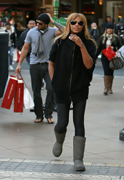 Eve went shopping at the Grove looking futuristic in gray sheepskin boots, leggings, and a zippered top.