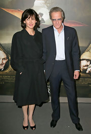 Sophie Marceau seems to love black peep toe pumps, and we love how they showed a little skin under her heavy wool coat.
