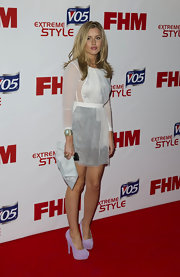 Caggie Dunlop carried a chic envelope clutch at an event by FHM.