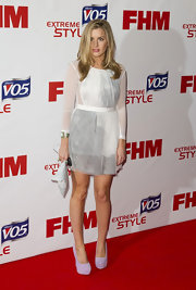 Caggie Dunlop arrived at the FHM Sexiest Women in the World Awards wearing a sheer mini dress.