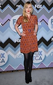 Dakota channeled the early '70s in this burnt orange print dress at the Fox All-Star Party.