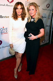 Jaclyn looked stunning on the red carpet in a white long-sleeve dress with shirred details.