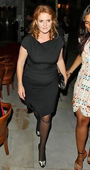 Sarah Ferguson looked classy wearing a cowl neck wrap dress at the Fashion for Relief Olympic Party.