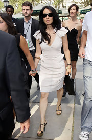 Lucy attended the glamorous affair wearing a fitted sheath dress and a thinly strapped pair of platform sandals. This t-strapped design can be paired with a dress or jeans.